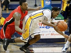 Ball State's Marcus Posley (3) fouls Toledo's Julius Brown (20) as he steals the ball against Ball State. Brown had three steals throughout the game.