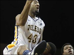 Toledo's forward Matt Smith (43) draws a charging foul as he attempts to score. Smith pulled down three rebounds, scored 16 points and had one block throughout the game.