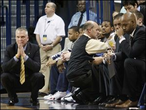 Toledo's head coach Tod Kowalczyk, left, watches his team from near the bench.