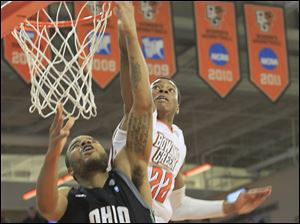 BGSU's #22, Richaun Holmes, blocks the shot of OU's #30, Reggie Keely in the first half.