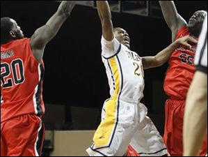 Toledo's guard Julius Brown (20) drives the lane.