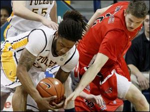 Toledo's Reese Holliday (32) grabbed a loose ball. Holliday scored six points and nabbed two steals throughout the game.