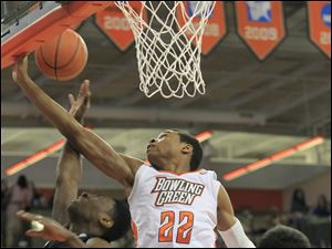 BGSU's #22, Richaun Holmes, stops OU's #20, Ricardo Johnson, from scoring.