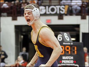 Archbold wrestler Logan Day celebrates after pinning Jared Dilley of Amanda-Clearcreek during their Division III 138 pound semi-final match.