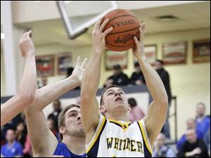 Whitmer's Nate Holley (34) takes a shot against Springfield's Logan Weimer (32).