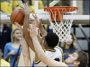 Whitmer's Nate Holley (34), Ricardo Smith (10), and  Springfield's Logan Weimer (32) battle for a rebound.