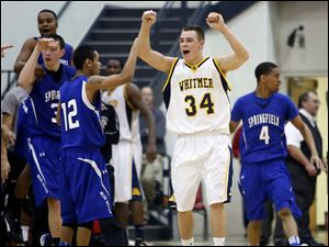 Whitmer's Nate Holley (34) celebrates a victory over  Springfield.