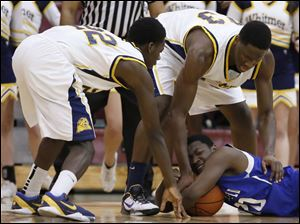 Whitmer's Nigel Hayes (23) and Jon Ashe (22) battle Springfield's Christian Jackson (20) for a loose ball.