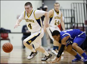 Whitmer's Luke HIckey (4) steals the ball from Springfield's Markese Hicks (22).