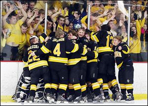 Northview's hockey team celebrates defeating St. John's 3-2 to claim the district championship and a return trip to the state tournament.