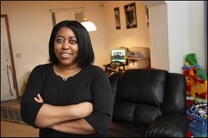 Danielle Peace has lived in her home on Fulton Street in Toledo since 1998. She is hoping to purchase the home, where she lives with her four children, through the Low Income Housing Tax Credit program.