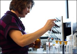 Research scientist Maria Yost works to create alcoholic beverages at Beam Inc.'s Global Innovation Center in Clermont, Ky.