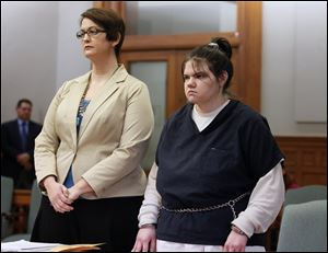 Jennelle McGuire, 20, of Oregon, right, with attorney Gretchen DeBacker, is sentenced in Lucas County Common Pleas Court for the fatal stabbing of her husband.