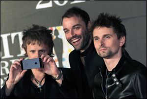 From left, Dominic Howard, Christopher Wolstenholme, and Matthew Bellamy of British band Muse.
