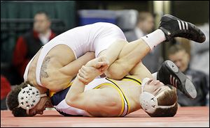 Archbold's Logan Day finds himself in trouble against J.J. Diven of Atwater Waterloo in the 138 final.