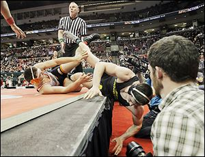 North Baltimore's Dalton Ismael, left, rolls Tyler Beck of Galion Northmor off the mat during their Division III 195-pound championship match at the Schottenstein Center. Beck won in OT.
