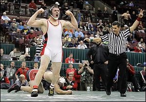 Wauseon's Zane Krall lets out a scream after scoring a takedown on Greg Moray of Steubenville to win their Division II 220-pound championship match.