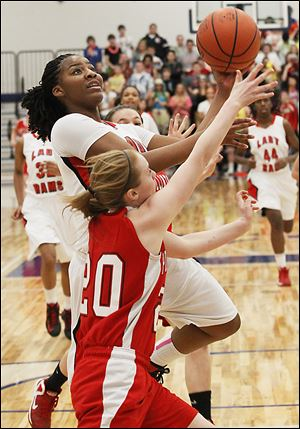 Rogers' junior Tatyana Reynolds goes in for a layup over Port Clinton freshman Marissa Day during the second half.