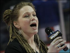 Crystal Bowersox sings the national anthem before the start of the Walleye game.