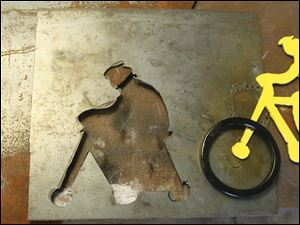 A drawing by Beth Scheffert, a cut out from a piece of metal, and the resulting figure on a bicycle.