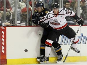 Toledo's Phil Oreskovic, left, is checked by Trenton's Alexandre Carrier during the first period.
