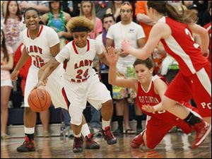 SPT D2girlsdistrict3 Rogers' senior Cha'Ron Sweeney (24) steals the ball from Port Clinton's junior Hope Thorbahn (33).