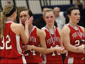 Port Clinton's junior Tiffany Colston (32) embraces teammate junior Paige Culver (24) as they receive their medals for runner up.