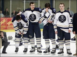 St. John's players react to their 3-2 loss.