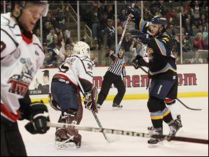 The Walleye's Trevor Parkes celebrates a goal during the first period.