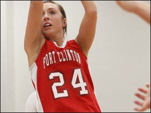 Port Clinton's junior Paige Culver (24) puts up a field goal during.