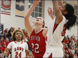 Port Clinton's junior Tiffany Colston (32) puts up two points from inside the paint.