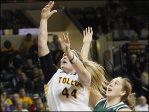 UT's Kyle Baumgartner is fouled on her shot by EMU's Chelsea Hite.