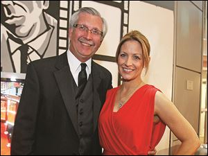 Co-chairmen of the American Red Cross' 10th annual Oscar Night, Kevin Kwiatkowski and Stephanie Kuhlman, take a moment in the evening for a photo.