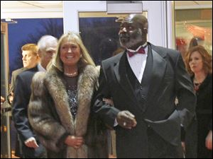 Karen Jarosz, left, and Toledo Mayor Mike Bell walk the red carpet.