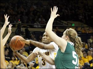 Toledo's Lucretia Smith drives past EMU's Chelsea Hite in the first half. Smith had a double double.