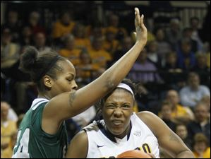 The Rockets' Yolanda Richardson drives to the basket while defended by EMU's India Hairston.