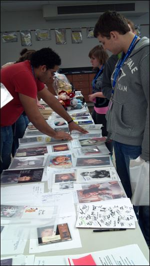 Attendees check out merchandise at the silent auction, the proceeds of which go to scholarships.