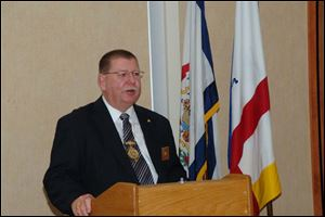 Knights of Pythias official L. Keith Stooksberry, Jr., says members 'take an obligation to pledge honor to God.'