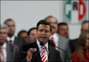 Mexico's President Enrique Pena Nieto delivers a speech during the national convention of the Institutional Revolutionary Party (PRI) in Mexico City. Mexico's ruling party changed on Sunday its platform to allow a reform that could bring private investment into the state-owned oil monopoly, in a country where oil is a source of national pride.