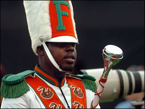 Robert Champion, a drum major in Florida A&M University's Marching 100 band, performs during halftime of a football game in Orlando, Fla.