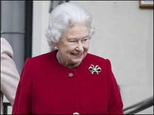 Britain's Queen Elizabeth II leaves the King Edward VII hospital  in London following a one-day stay caused by a stomach ailment.