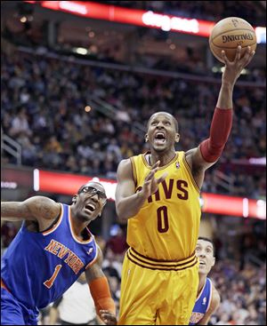 C.J. Miles shoots around New York's Amare Stoudemire. Miles scored 11 points in the home loss.