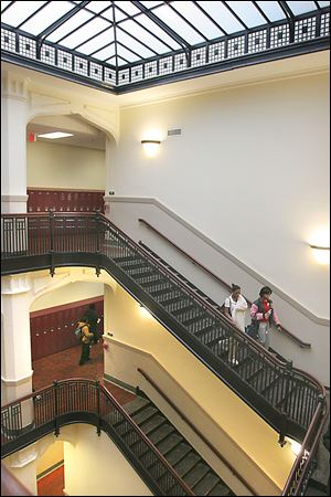 New skylights illuminate the stairways at the renovated Scott High School. The building was originally among those set for demolition, but the district revised its plans to the delight of many alumni who had hoped the building would be preserved.