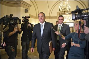 House Speaker John Boehner of Ohio arrives on Capitol Hill in Washington after a meeting at the White House between President Obama and Congressional leaders before billions of dollars in mandatory budget cuts were to start. The Friday meeting — lasting less than an hour — yielded no immediate results.