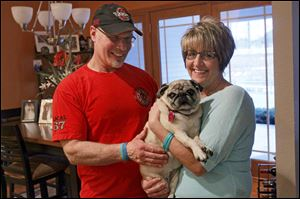 Ken and Debbie Balogh care for two special-needs dogs. Mugsy, a 9-year-old pug, is blind and needs twice daily shots for diabetes. Their golden retriever, Hayes, 14, needs help getting outside.