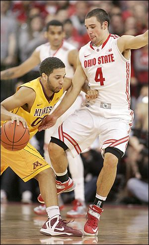Ohio State's Aaron Craft slows down Minnesota's Julian Welch. The 21-7 Buckeyes are ranked No. 14.