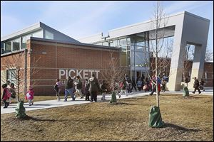 Students exit Pickett Academy in Toledo. Since 2002, Toledo Public Schools has undergone an extensive facilities upgrade, building or renovating more than 40 buildings. Pickett Academy was the last to open.