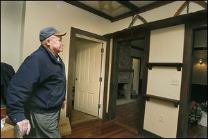 Douglas Pratt admires the wooden trim and pine flooring that he donated to the Perrysburg Area Historic Museum — otherwise known as the Aurora Spafford House — in Perrysburg.