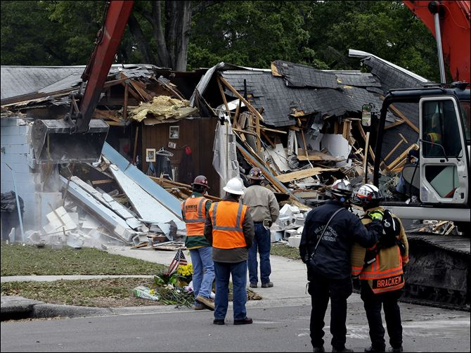 Sinkhole Swallows Man Demolition experts watch as a home is destroyed Sunday after a sinkhole opened up underneath it late Thursday evening swallowing Jeff Bush, 37,