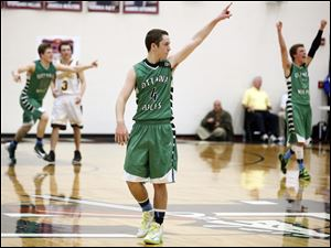 Ottawa Hills' Ben Silverman (4) celebrates the victory.